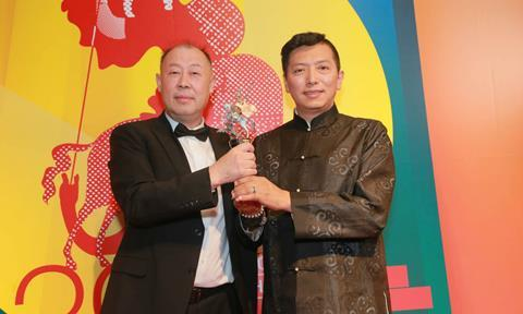 Crested Ibis director Qiao Liang and producer Duan Peng with the Golden George
